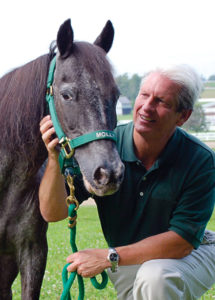 John Nicholson and Molly the pony Photo by Maureen Gallatin